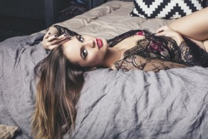 Young beautiful woman in luxury lingerie fashionable brunette in the bedroom